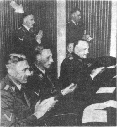 Three SS men: from the left: Karl Frank, Rudolf Heydrich (sitting) and Theodore Oberlnder (standing)